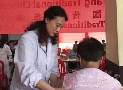 中国与毛里求斯签署中医针灸合作意向书